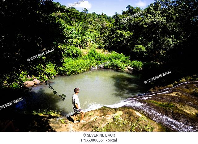 man in front of the concord waterfall, Grenada, West Indies, Antilles