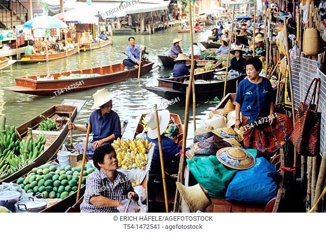 Thailand, many boats on the banks of the Floating Market