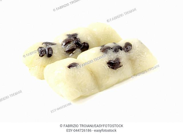 Khao Tom Mad (Sticky Rice with Banana and Black Beans) on a white background
