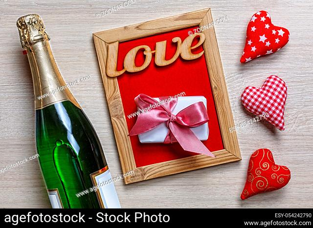 Women's Day, 8 March. Valentine's Day. Valentine's Day card. Champagne, gift box and red roses. Layout. Free space for text