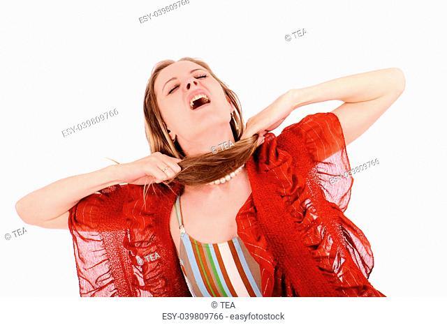 Pretty woman tearing her hair