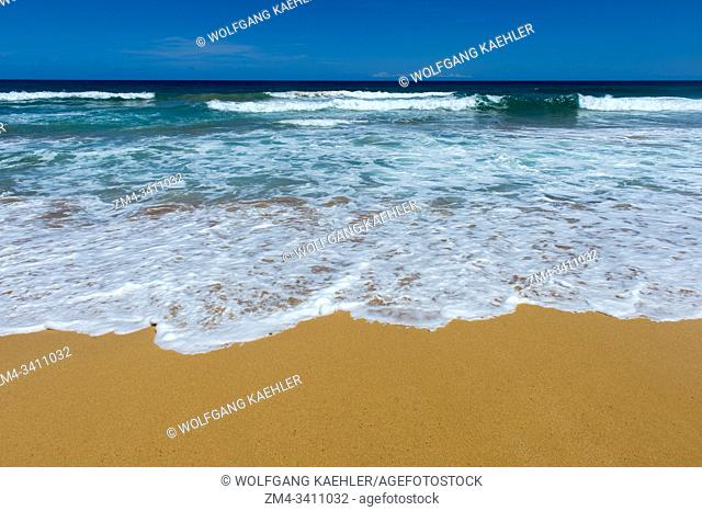 View of the white sand beach at Kealia Beach Park near Kaapa on the eastern side of the Hawaiian Island of Kauai, Hawaii, USA