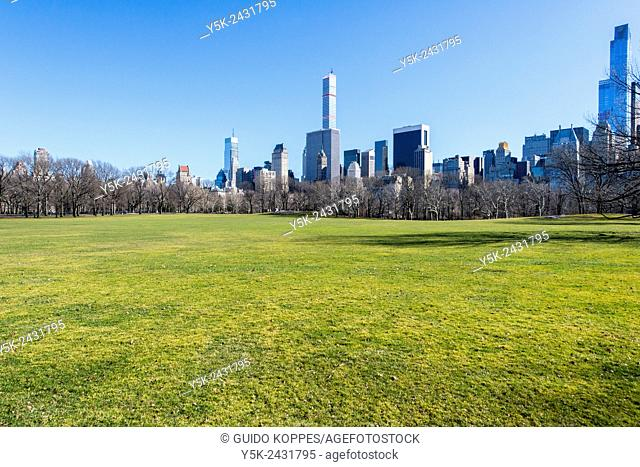 New York, USA. Scheeps meadow in South Central Park, Manhattan, with view on 5th Ave & 59th Street