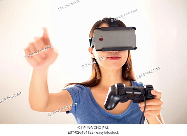 Woman play with videoo game with virtual reality device