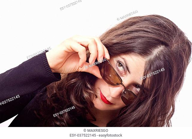 Isolated portrait of girl looking over the glasses