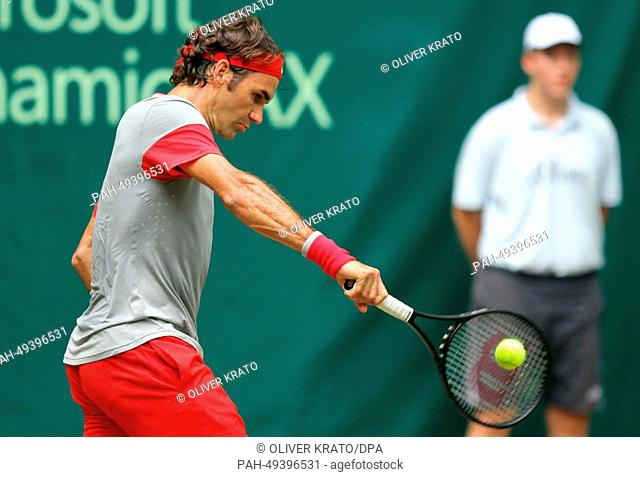 Swiss tennis player Roger Federer in action during the final match against Colombia's Alejandro Falla at the ATP tournament in Halle (Westphalia), Germany