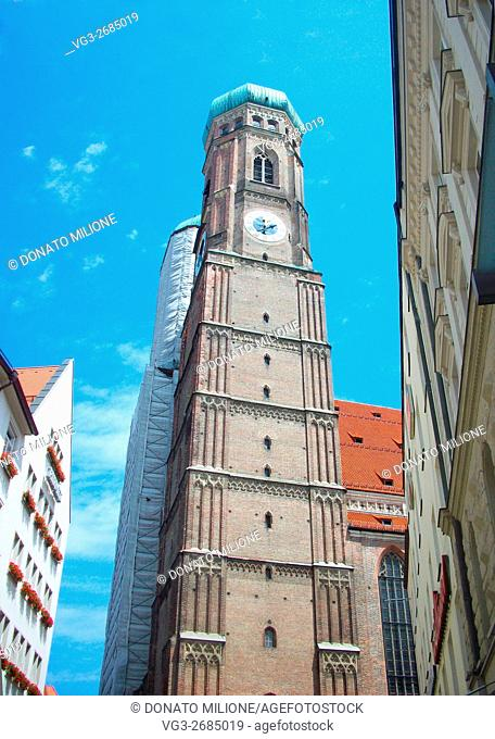 One of the two clock towers of Frauenkirche, 99 meters tall twins and with the tip onion-shaped. Frauenkirche is the Cathedral of Munich and it was built in the...