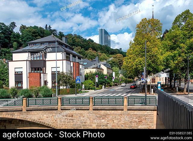 Luxembourg city, Luxembourg - August 21, 2018: Downtown Luxembourg city along river Grund with view at European Kirchberg district with big office building