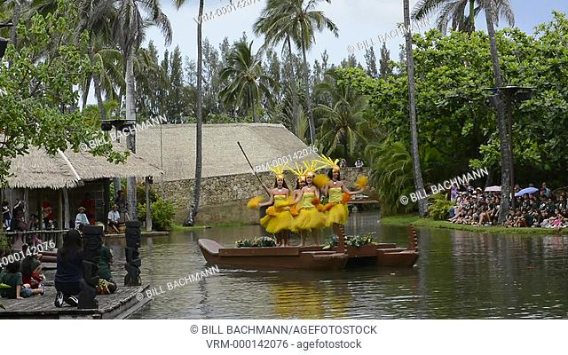 Laie Hawaii Polynesian Cultural Center tourist boats on canals with flowers around park