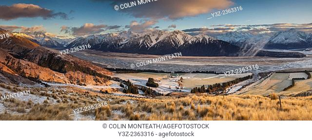 Glenfalloch high country sheep station, dawn panorama after winter snowfall from above Rakaia river, Canterbury