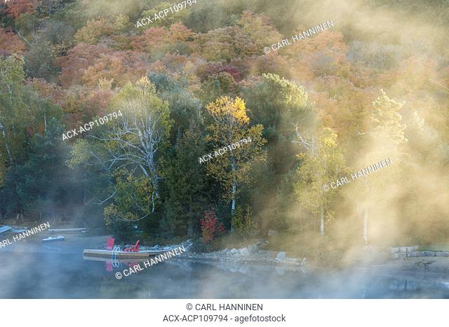 Fog on an autumn morning, Oxtongue Lake, Ontario, Canada