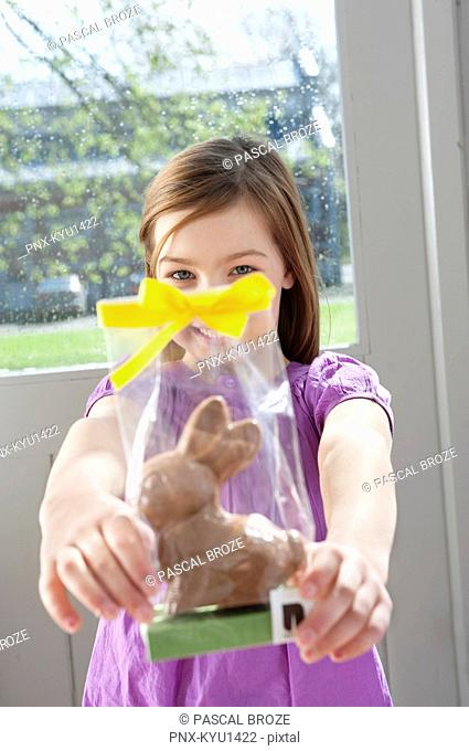 Portrait of a girl holding an Easter bunny in front of her face