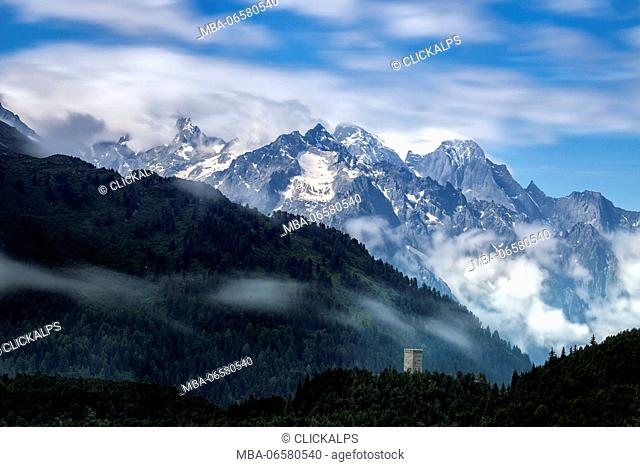 Fog on Tower Belvedere with Pizzo Badile surrounded by clouds, Maloja Pass, Engadine, Canton of Graubunden, Switzerland Europe
