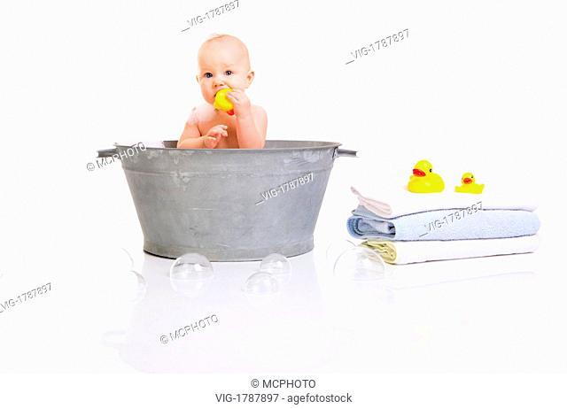 Bath Time. Cute happy baby girl having bath. Isolated on white. - 01/01/2009