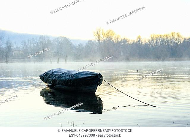 moored boat in the morning at dawn on Lake Maggiore
