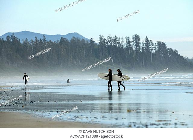People, family, and surfers on Long Beach, Tofino, Vancouver Island, BC, Canada