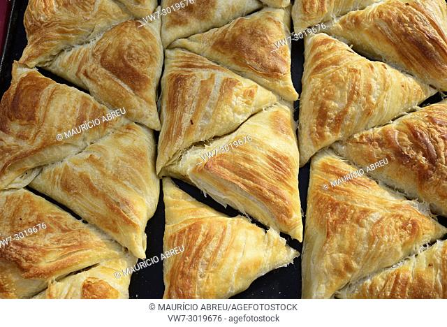 Samsa (samosa), a fried or baked dish with a filling of vegetables and minced lamb or beef. Dekhon bazaar, Khiva. Uzbekistan