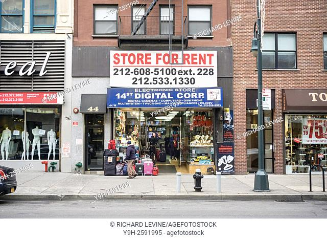 An electronics store in the 14th Street central business district with a sign implying their imminent closing in New York