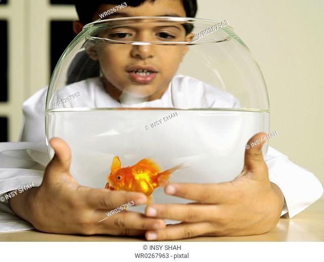 Arab Boy Holding Aquarium