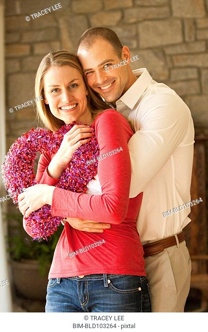 Caucasian couple holding heart