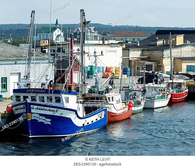 Boats mooring in a row along the waterfront; Bonavista, Newfoundland and Labrador, Canada
