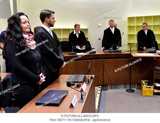 11 July 2018, Munich, Germany: The defendant Beate Zschäpe is next to her lawyer Mathias Grasel while the presiding judge Manfred Götzl (2nd from right) and the...