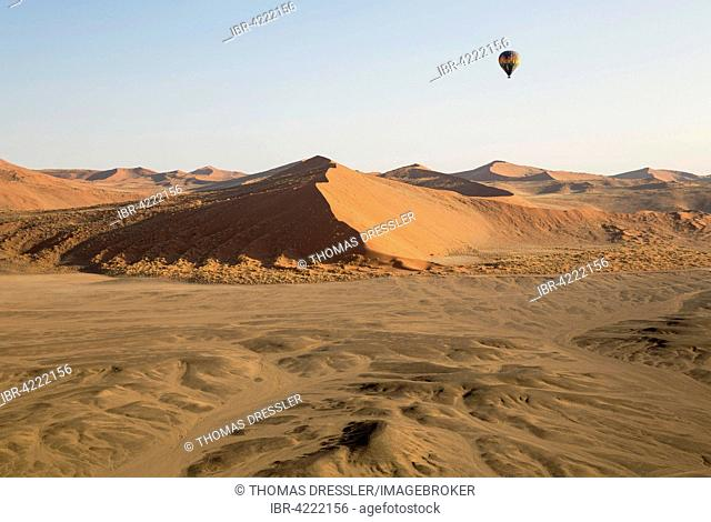 Hot-air balloon above the sand dunes of the Namib Desert, photographed from a second balloon, Namib-Naukluft National Park, Namibia