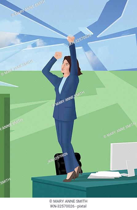 Businesswoman standing on desk breaking up glass roof
