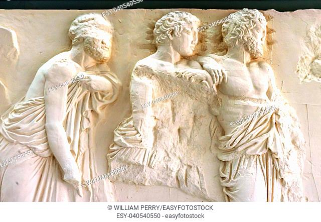 three old men, old men, Athenians, Greeks, ancient greeks, Marble Panel Parthenon Acropolis Athens Greece. Parthenon created 438 BC and is symbol of ancient...