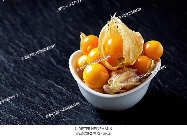 Bowl of Physalis on slate