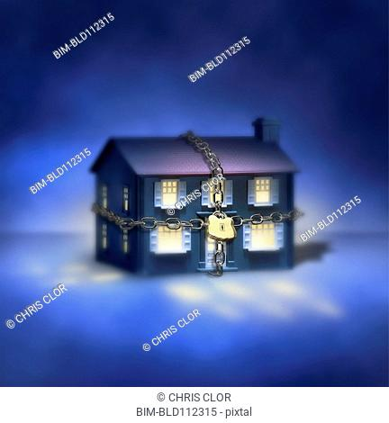 Illuminated house with chain and padlock