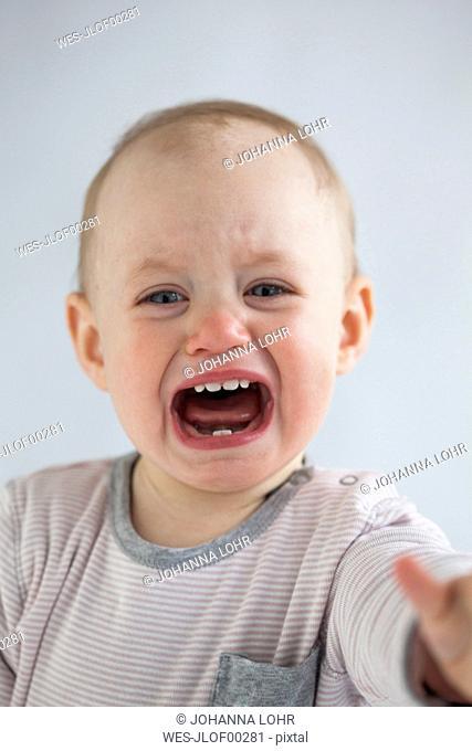 Portrait of screaming baby girl