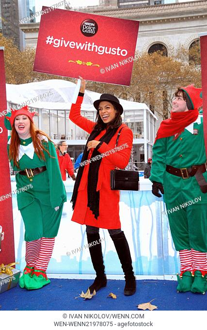 Rosario Dawson and 100 elves spread holiday cheer in Bryant Park Featuring: Rosario Dawson Where: Manhattan, New York, United States When: 02 Dec 2014 Credit:...