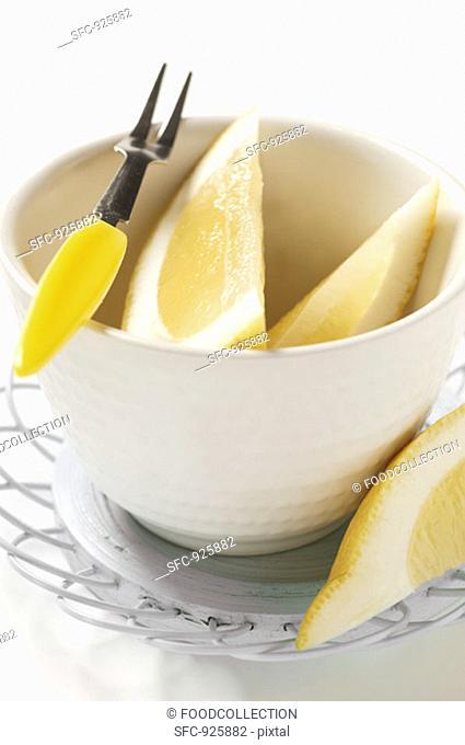 Lemon wedges in small bowl