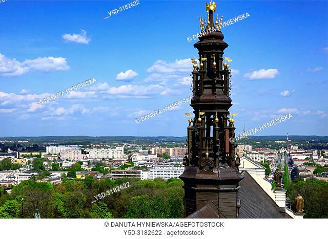 View for main avenue in Czestochowa - Holy Virgin Mary Avenue, in front foreground close-up of tower of Jasna Gora Basilica