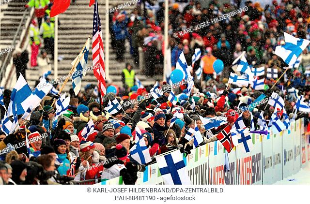 Visitors hold up the flags of competing nations at the Nordic World Ski Championships in Lahti, Finland, 26 February 2017