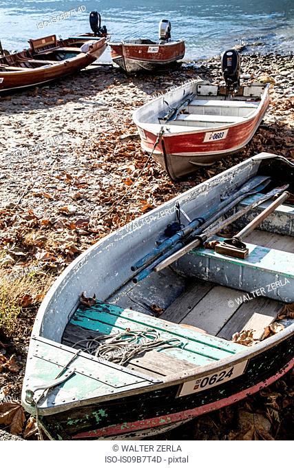 Boats on beach at Isola Pescatori, Lake Maggiore Piedmont, Italy