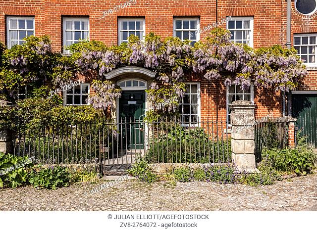 A house adorned with wisteria in the historic Close in Salisbury, Wiltshire