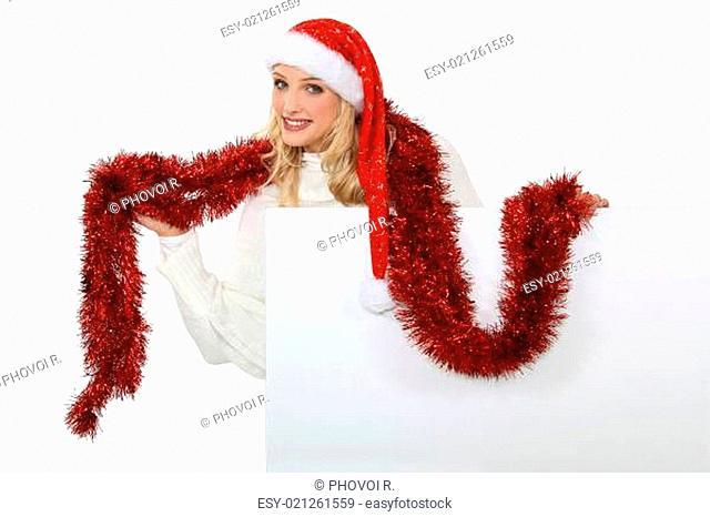 Mrs Santa using a tinsel as a scarf