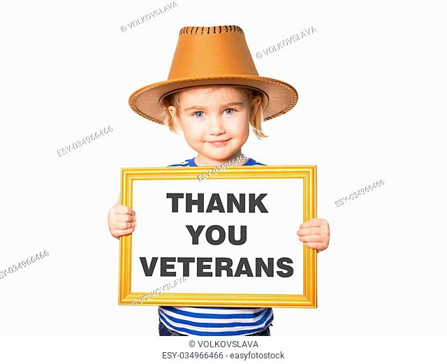 Little Funny girl in striped shirt with blackboard. Text THANK YOU VETERANS. Isolated on white background