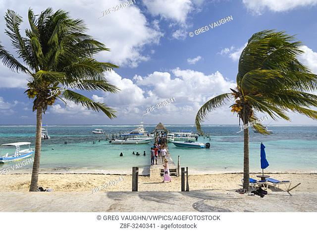 The malecon and Pelicanos Yacht Club pier in Puerto Morelos, Riviera Maya, Mexico
