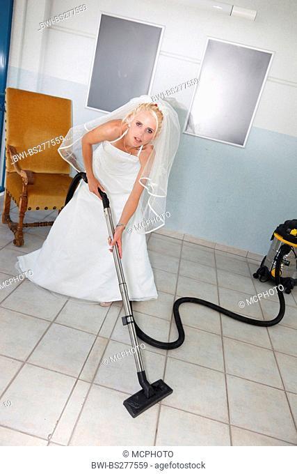 bride using vacuum cleaner