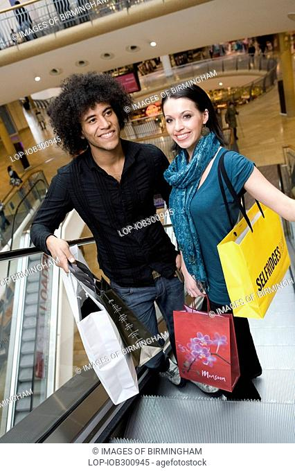 England, West Midlands, Birmingham, A young couple shopping in the Bullring shopping centre in Birmingham
