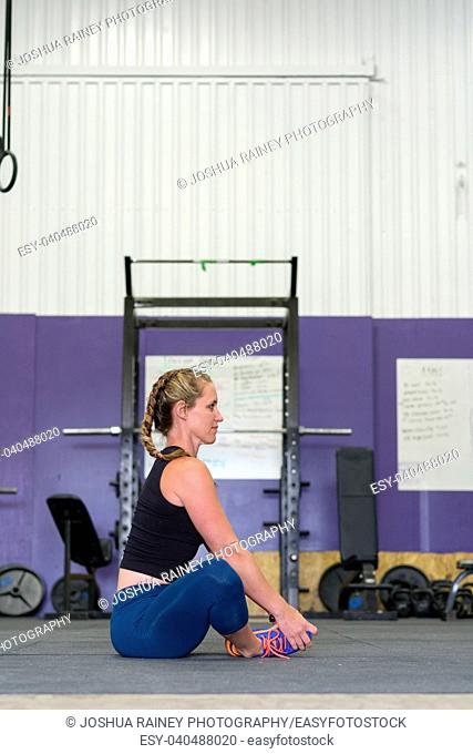 Female stretching during a workout at a gym that focuses on crosstraining