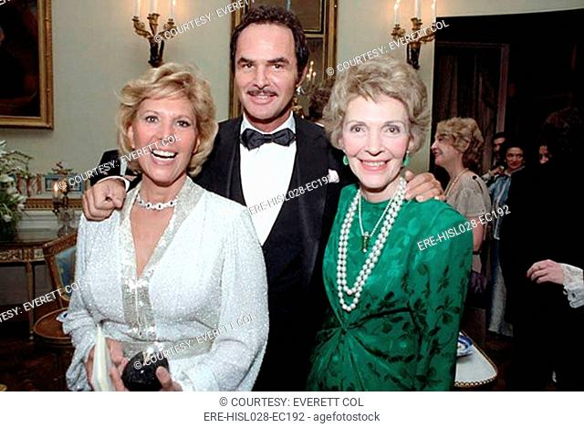 First Lady Nancy Reagan with Dinah Shore and Burt Reynolds in the Blue Room during a state dinner for Premier Zhao Ziyang of the Peoples Republic of China