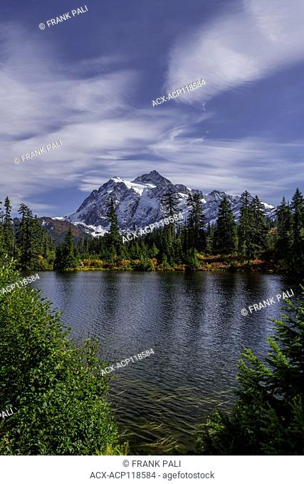 WASHINGTON - Mount Shuksan reflecting in Picture Lake in Heather Meadows Recreation Area in the North Cascades.Fall colours are abundant in the vegetation
