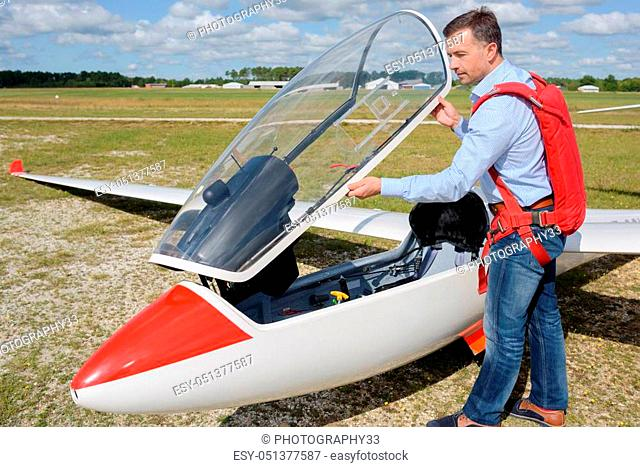 man ready to fly an ultralight propeller-driven airplane