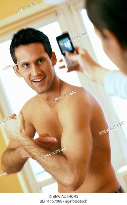 Woman taking pic of man