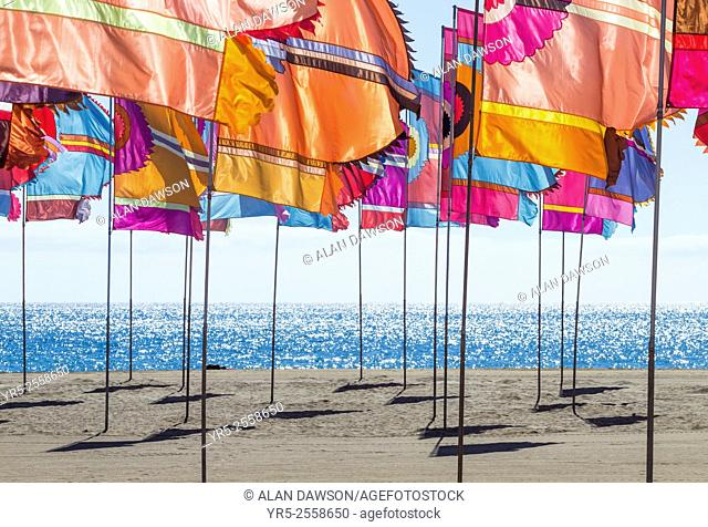 Womad flags on Gran Tarajal beach during 2015 Womad music festival. Gran Tarajal, Fuerteventura, Canary Islands, Spain