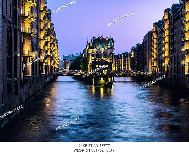 Germany, Hamburg, view to lighted Old Warehouse District at blue hour